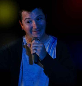 A comedian doing his thing on stage